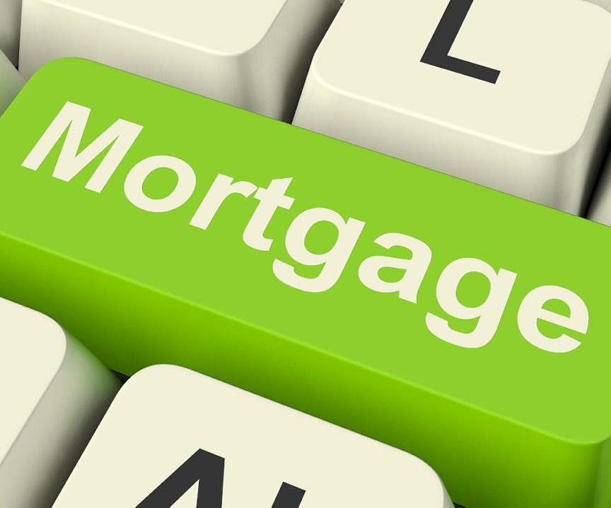 A green key that says Mortgage on a keyboard